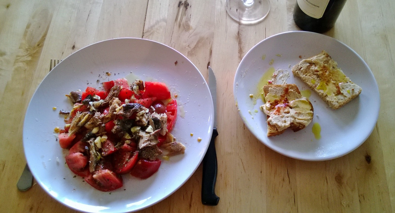 Heirloom tomatoes, smoked herrings, salt, minced garlic, basil, Arbequina extra virgin olive oil + hummus italian bread toasts with paprika and more... extra virgin olive oil